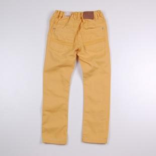 Фото: Детские джинсы желтого цвета с манжетами купить  (артикул O 60074-yellow) - изображение 4